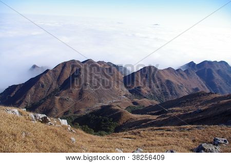 Mountaintop at winter with white rocks and yellow grass