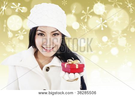 Christmas Gift For You In Golden Defocused Lights Background
