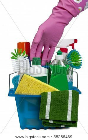 Gloved Hand Reaching For Cleaning Products