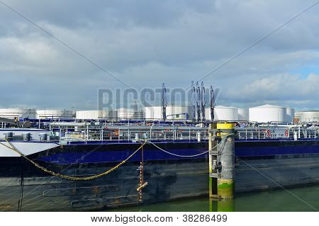 oil refinery and oil tanker in the harbor of rotterdam netherlands