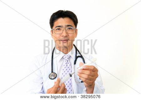 Smiling asian medical doctor