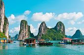 stock photo of raft  - Floating village and rock islands in Halong Bay Vietnam Southeast Asia - JPG