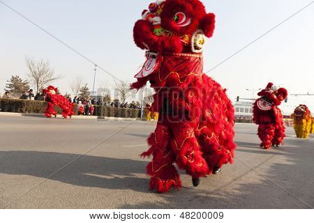 YU COUNTY CHINA FEBRUARY 5: People performing traditional lion dance for celebrating Lantern Festival on February 11 2013 at Yu County, China.