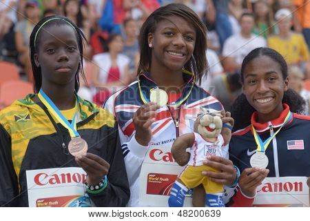 DONETSK, UKRAINE - JULY 13: Medalists in 400 m during 8th IAAF World Youth Championships in Donetsk, Ukraine on July 13, 2013. Left to right: T. James, Jamaica, S. Bakare, Great Britain, O. Baker, USA