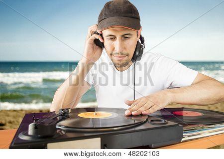 Dj Mixing Vinyl Record On A  Turntable