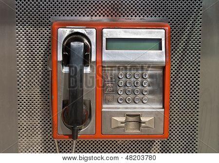 Orange Public Telephone On Metallic Background