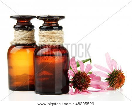 Medicine bottles with purple echinacea, isolated on white