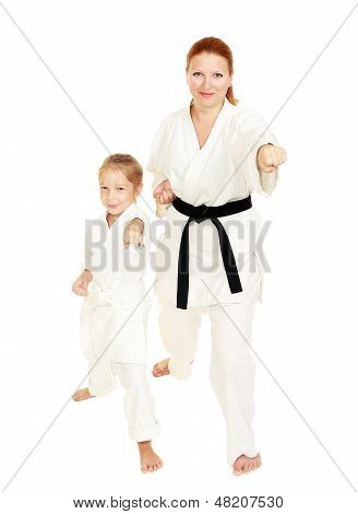 Mom and daughter in kimono punch hand