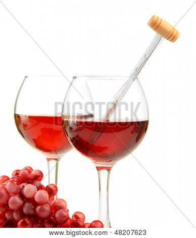 Glasses of wine with thermometer and grape, isolated on white