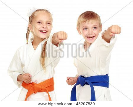 Girl and boy in a kimono on a white background beat hand