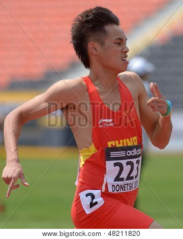 DONETSK, UKRAINE - JULY 12: Youxue Mo of China win the heat in 200 metres during 8th IAAF World Youth Championships in Donetsk, Ukraine on July 12, 2013