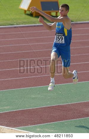DONETSK, UKRAINE - JULY 12: Pavlo Beznis of Ukraine competes in the triple jump during 8th IAAF World Youth Championships in Donetsk, Ukraine on July 12, 2013