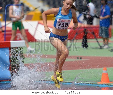 DONETSK, UKRAINE - JULY 12: Oksana Hach of Ukraine competes in 2000 m steeplechase during 8th IAAF World Youth Championships in Donetsk, Ukraine on July 12, 2013