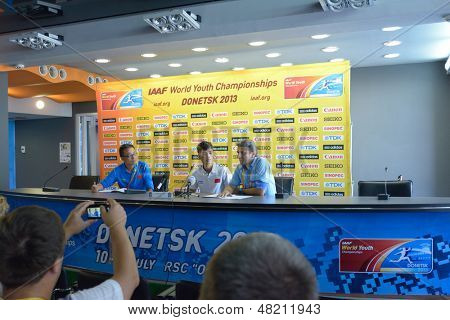 DONETSK, UKRAINE - JULY 12: Youxue Mo of China (in center) on the press conference during 8th IAAF World Youth Championships in Donetsk, Ukraine on July 12, 2013