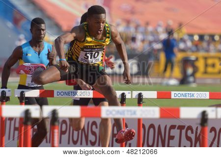 DONETSK, UKRAINE - JULY 12: J. Hyde of Jamaica and X. Coakley of Bahamas (left) compete in semi-final of 110 m hurdles during 8th IAAF World Youth Championships in Donetsk, Ukraine on July 12, 2013