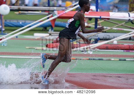 DONETSK, UKRAINE - JULY 12: Rosefline Chepngetich of Kenya competes in 2000 m steeplechase during 8th IAAF World Youth Championships in Donetsk, Ukraine on July 12, 2013