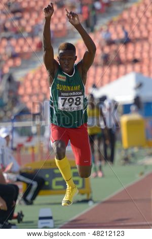 DONETSK, UKRAINE - JULY 12: Dave Pika of Surinam compete in triple jump during 8th IAAF World Youth Championships in Donetsk, Ukraine on July 12, 2013