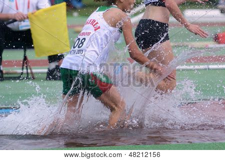 DONETSK, UKRAINE - JULY 12: Sabrina Yahi of Algeria competes in 2000 m steeplechase during 8th IAAF World Youth Championships in Donetsk, Ukraine on July 12, 2013