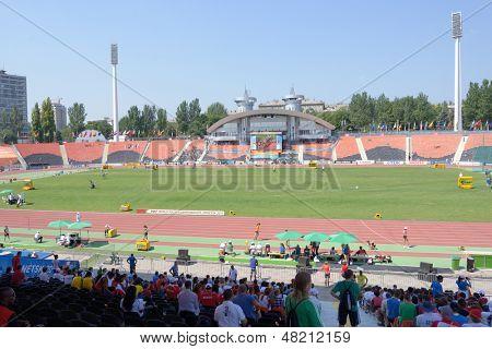 DONETSK, UKRAINE - JULY 13: People on the Stadium RSC Olimpiyskiy during 8th IAAF World Youth Championships in Donetsk, Ukraine on July 13, 2013