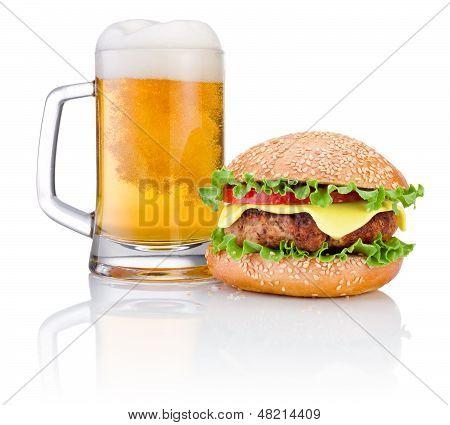 Hamburger And Mug Of Beer Isolated On White Background