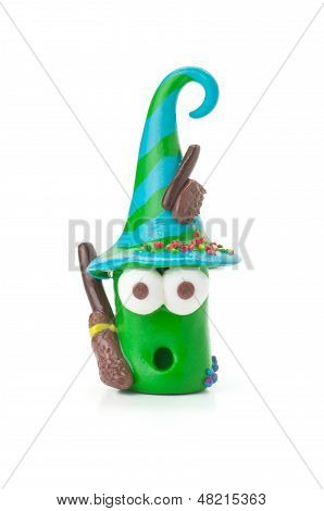 Handmade modeling clay figure with brooms on a white background