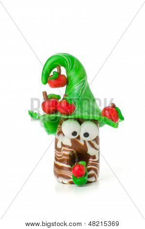 Handmade modeling clay figure with apples on a white background