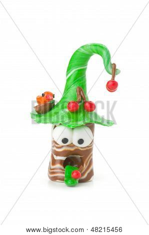Handmade modeling clay figure with cherries on a white background