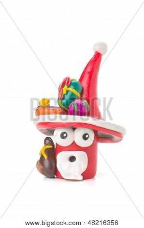 Handmade modeling clay Santa figure on a white background