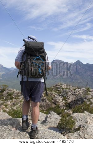 Old Man Hiking On Mountain Top 2