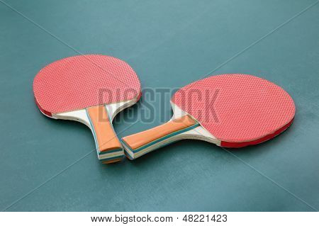Ping Pong Paddles On A Board
