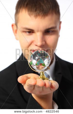 Young Businessman With Glass Globe On Palm