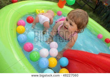 Little girl in kids pool