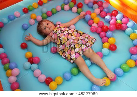 Little girl in a bouncy castle