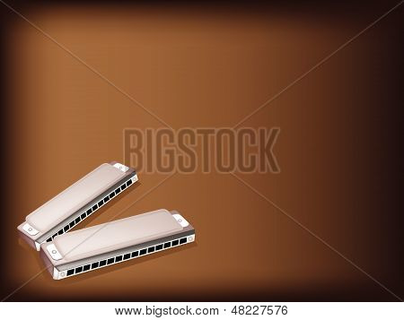 A Blues Harmonica On Dark Brown Background