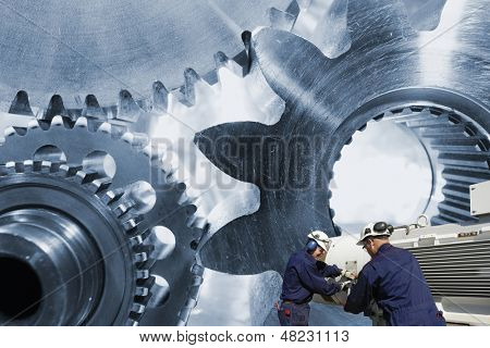 industry engineers operating a giant gear and axle machinery, blue toned background