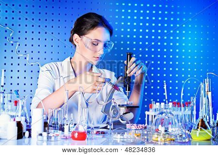 Employee of the laboratory in the working process. Laboratory equipment.