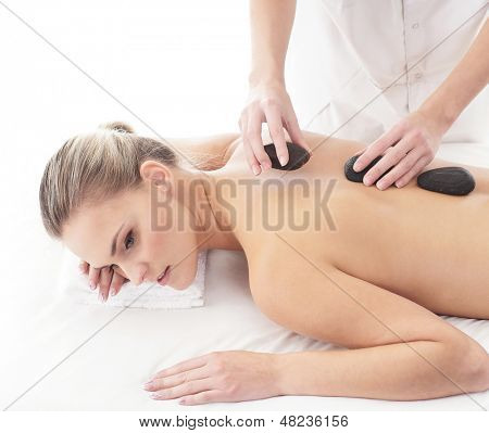 Young, beautiful and healthy woman getting spa treatment isolated over white background