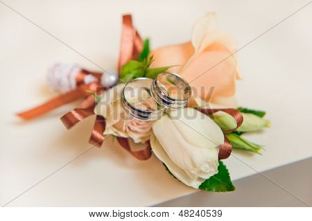 wedding boutonniere and wedding rings