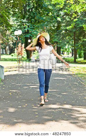 Beautiful young woman walking in park of Mataruska banja, Serbia.