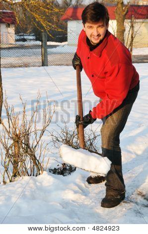 Adult Man Clean Owns Yard Against Snow