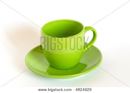 Green Tea Cup And Saucer On White Background.
