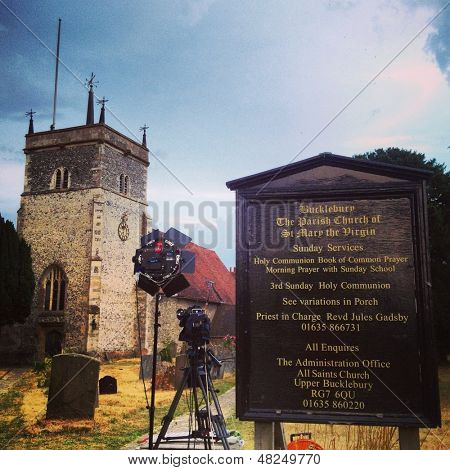 BUCKLEBURY - JULY 22: Press reporting camera and lighting equipment prepared to report the birth of the royal baby outside the parish church on July 22, 2013 in Bucklebury, UK.