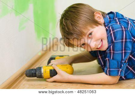 Boy Worker Installing Plinth