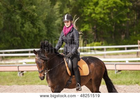 Girl Rides Her Pony