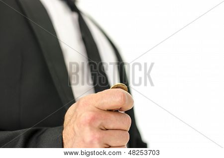 Business Man Flipping A Coin