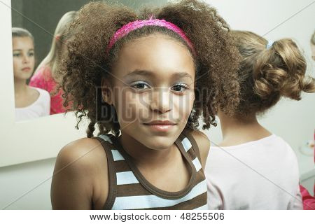 Closeup portrait of a young girl in bathroom with friends