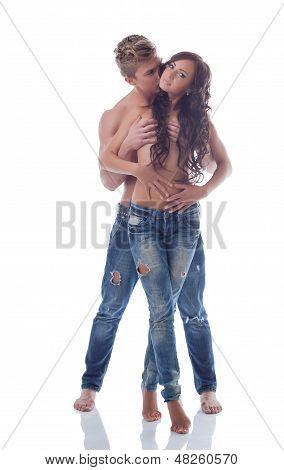 Beautiful pair of sexual partners posing in studio