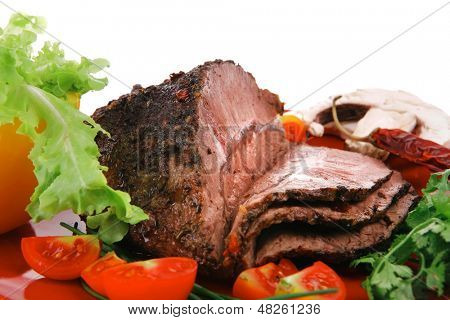 beef slice on red plate and vegetables