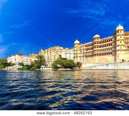 Pichola lake in India Udaipur Rajasthan. City buildings reflection on water