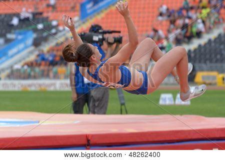 DONETSK, UKRAINE - JULY 11: Kseniya Novikova of Russia competes in pole vault during 8th IAAF World Youth Championships in Donetsk, Ukraine on July 11, 2013